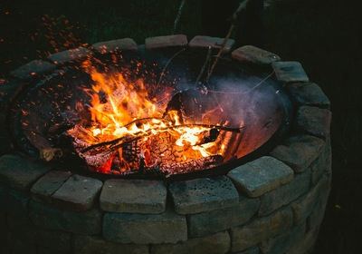 Fire and Water: Warming Up Your Pool and Patio with a Fire Pit